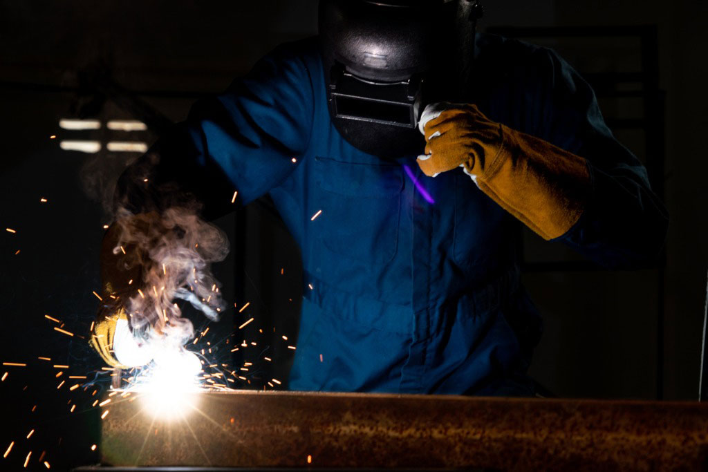 welder fixing a pipe